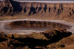 A salty lake lies at the bottom of Wahba crater