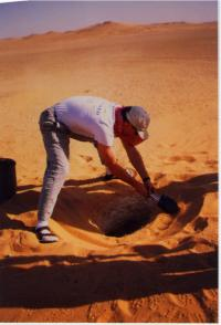 Mike cleaning sand around Teapot entrance